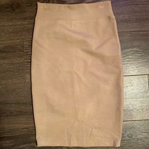 2 midi pencil skirts in solid colors.